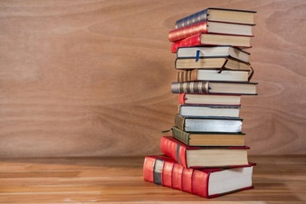 stack-of-various-books-on-a-table_1252-710